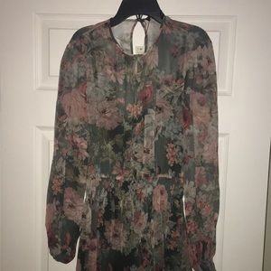 Sheer floral dress with green lining inside